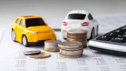 Coins, cars with calculator on financial statement