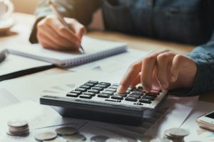 close up hand businesswoman using calculator for calculate finance accounting in office